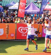 David (hands in the air) and his brother (thumb up) crossing the finish line of the Comrades in Durban.