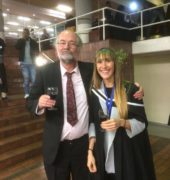 Photograph of Camille and her supervisor Chris Harris celebrating after the graduation ceremony
