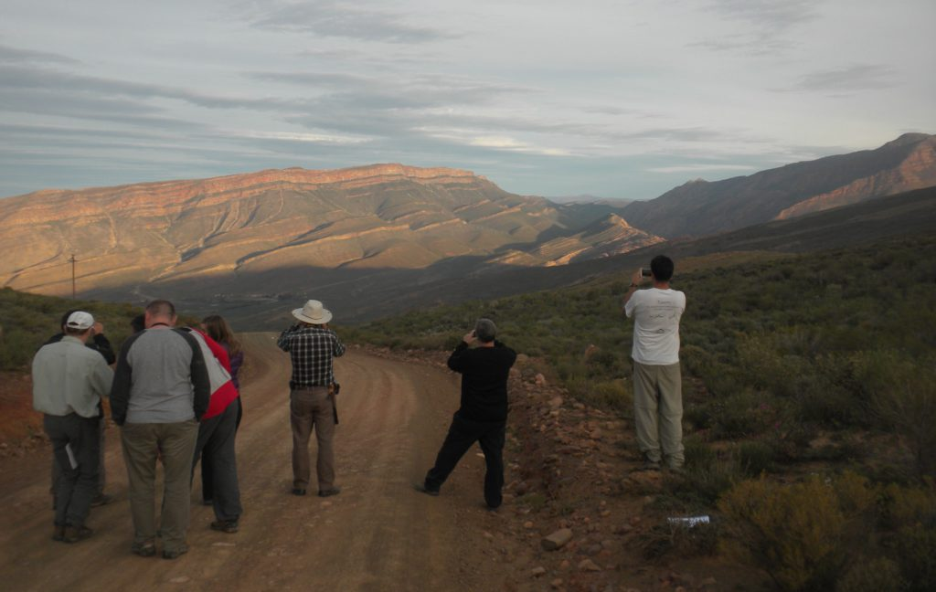Pre-11 CFB Trip delegates enjoying the sunset view of the Bokkeveld Group stratigraphy at Mount Ceder