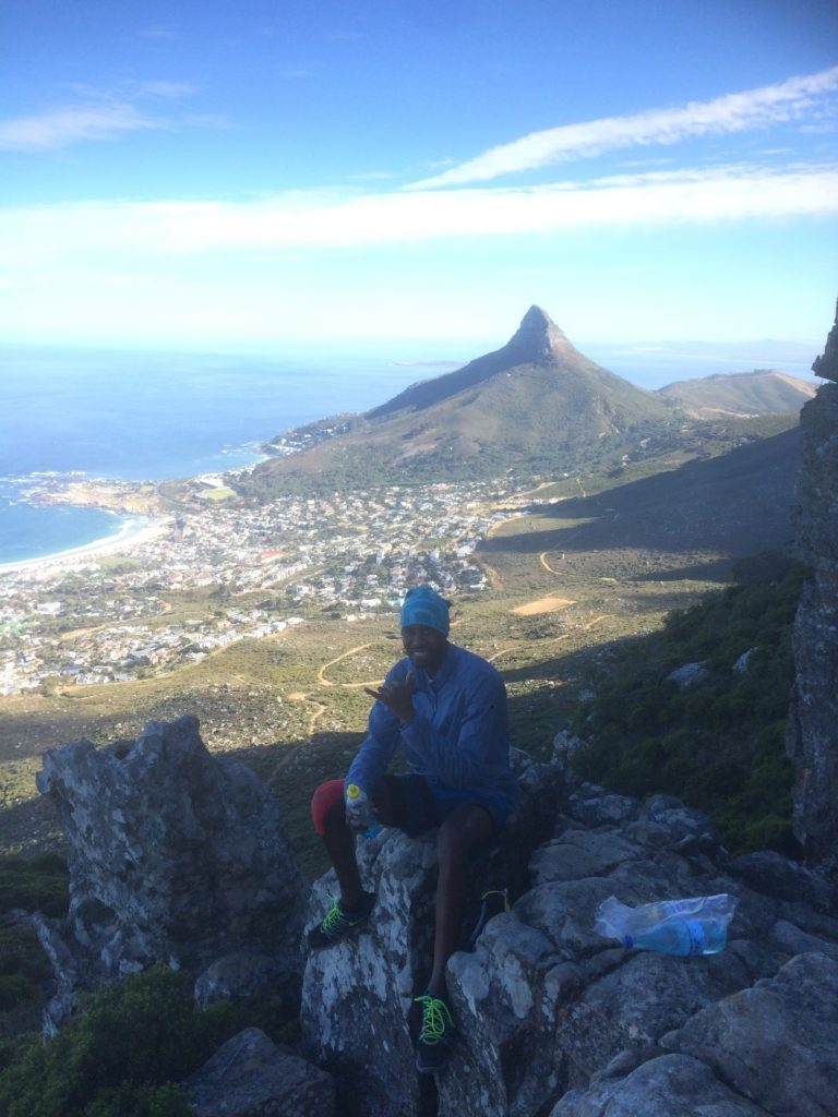 Lunga taking a break in front of Lion's Head and Camps Bay shinning in the distance.
