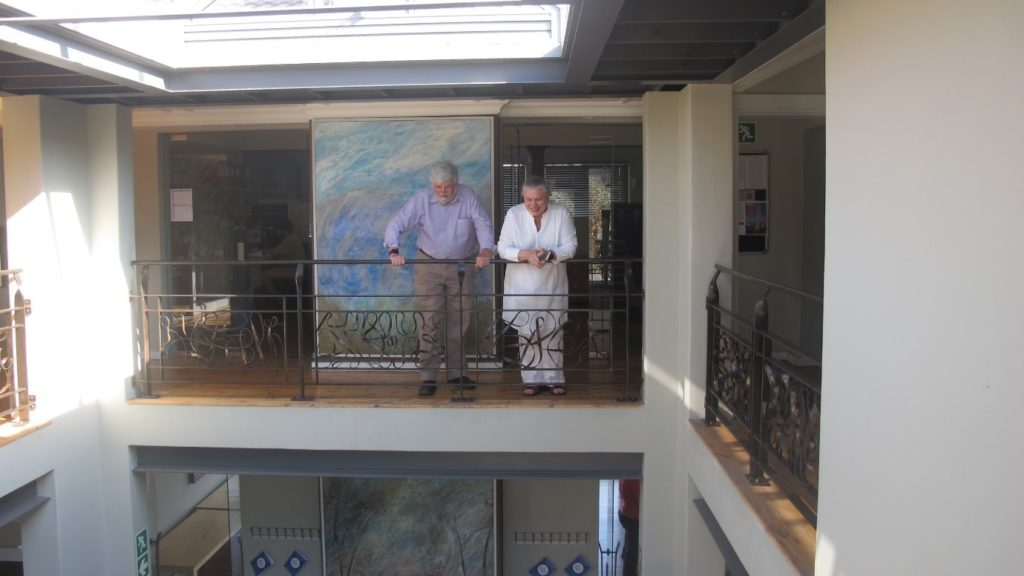Rowena Hay (MD at Umvoto) and Chris Hartnady (Research and Technical Director at Umvoto) looking down at the party being prepared.