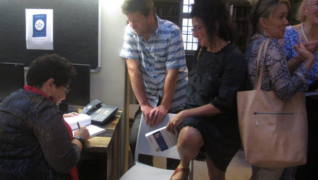 Rosemary signing Kornelius Riemann's (Principal Hydrogeologist & Associate at Umvoto) book.