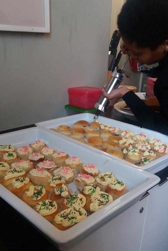 Kgomotso Mokoena Icing the muffins.